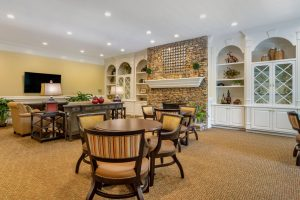 Charter Senior Living of Buford Image Gallery - Community Cafe with fireplace