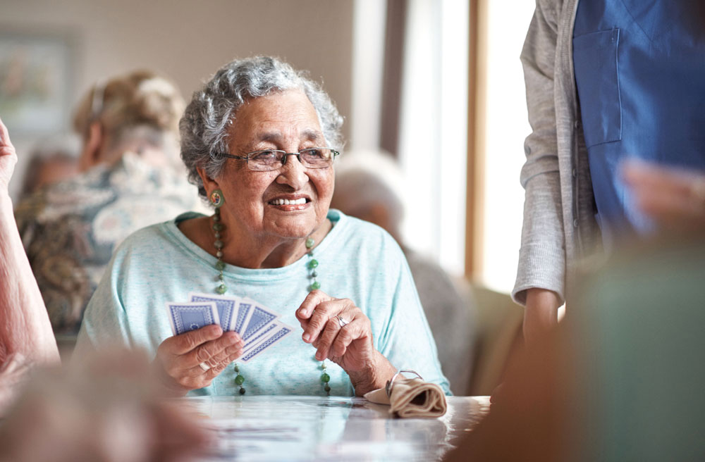 Charter Senior Living of Buford resident playing cards with friends