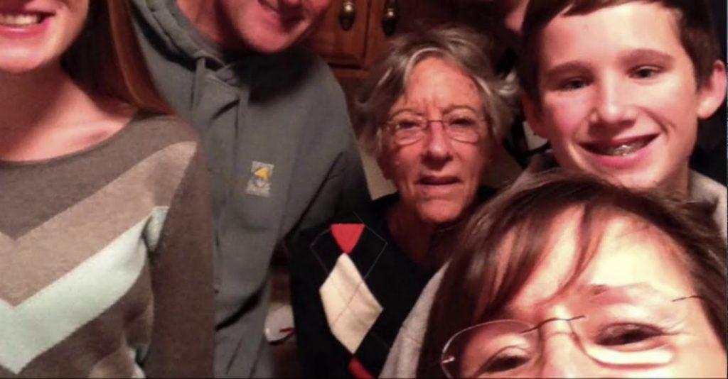 Charter Senior Living of Buford Video Thumbnail Family Group Surrounded by senior living resident
